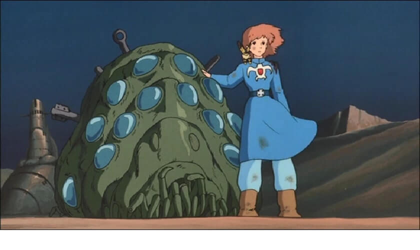 Nausicaa is standing in front of the Ohm charging eventhough she knows they will run her over